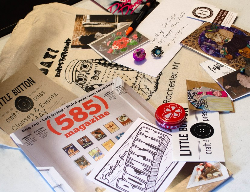 Lots of goodies including a 585 magazine, earrings from Peppermint, little treats from Prismatic Gardens, rings from Sunshyne Silverwear, free truffle coupon from Hedonist, notecards from  Fawnsberg and Carrie Lindstrom, hand stamped postcard from Jackbear Stamps, cute tags from Making the Nest of It, plus lots more are in the swag bags this spring. To top it off, everything comes bundled in a limited-edition screen printed Mayday! Underground canvas tote bag!